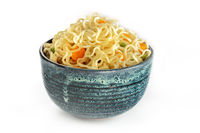 Instant noodles with carrot and scallions, vegetable soba bowl on white