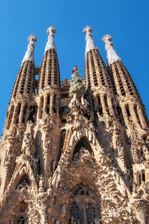 Barcelona, Spain - May 3, 2016: Tourist visiting Cathedral of La Sagrada Familia on May 3, 2016 in Barcelona, Spain. It is designed by architect Antonio Gaudi and is being build since 1882.