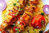 Shish kebabs with vegetables and bulgur