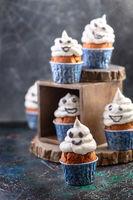 Funny ghost cupcakes. Halloween food idea.