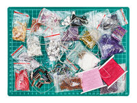 various embroidery items on cutting mat isolated