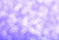 Bright round light bokeh of pale purple color