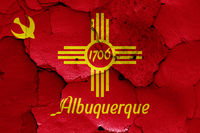 flag of Albuquerque painted on cracked wall