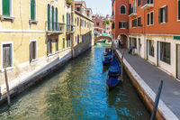 Venice canal with gondolas, peaceful view, Italy