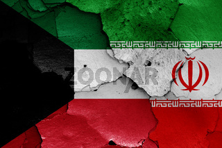 flags of Kuwait and Iran painted on cracked wall