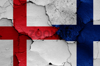 flags of England and Finland painted on cracked wall