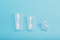 Squashed empty plastic cups collected to recycling
