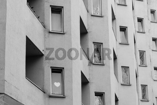 Heart behind the window of an apartment building