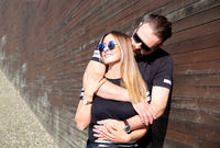portrait of stylish confident young couple models in sunglasses