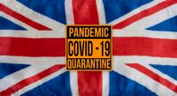 Pandemic sign warning of quarantine due to Covid-19 or corona virus in the UK
