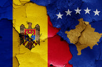 flags of Moldova and Kosovo painted on cracked wall