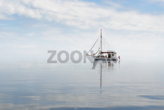 Cutter in misty sea