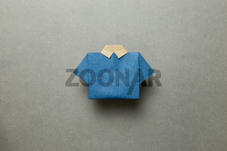 Blue paper shirt origami on gray background