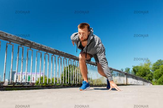 young man running across city bridge