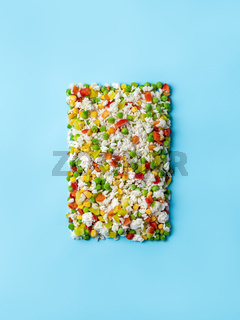 Frozen vegetables assorted on blue, top view