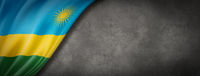 Rwanda flag on concrete wall banner