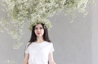 Portrait of sensual brunette woman with flowers wreath