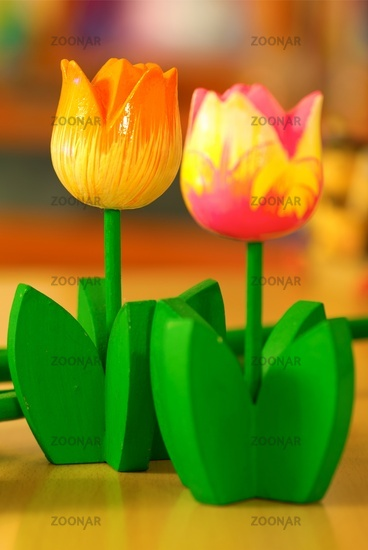 The wooden statue of (yellow) tulips flowers