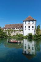 Canoeist on the Rhine by the Rheinau monastery island in Switzer