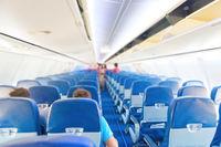 Empty plane interior with few people