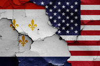 flags of New Orleans and USA painted on cracked wall