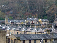 rooftop view of rows of traditional terraced streets and stone houses in hebden bridge west yorkshire