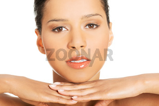 Portrait of attractive women proping her head.