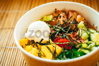 Asian salmon salad with mango, cream cheese and veggies for healthy diet, food delivery service and order online