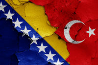 flags of Bosnia and Herzegovina and Turkey painted on cracked wall