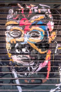 Colorful human face on graffiti artwork