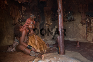 Kamanjab, Namibia - March 14, 2017: Himba woman with traditional hairstyle in Otjikandero Himba Orphanage Village