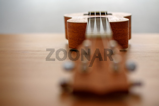 Brown ukulele with shallow depht of field
