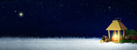First Advent. Christmas lantern on white snow.