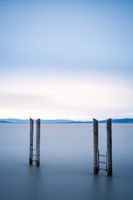Long exposure of poles lake neusiedlersee in Burgenland