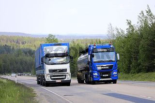 Tanker Overtakes Another Truck Uphill
