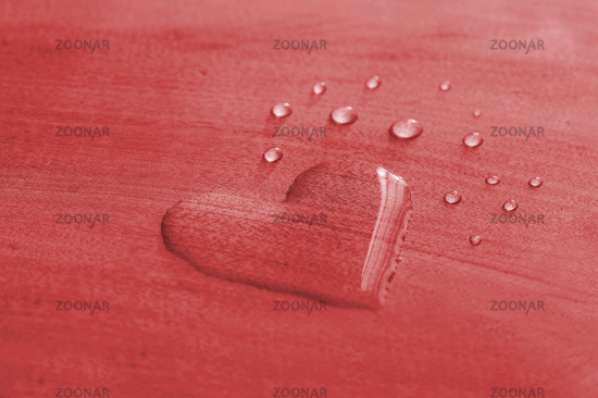 Water Drops in shape of heart on a red wooden Background, valentines day concept. Heart Shape Water
