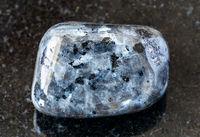 tumbled Larvikite (Labradorite) rock on black
