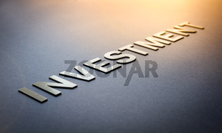 Word investment written with white solid letters