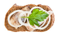 top view of sandwich with herring, onion, parsley