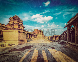 Vintage retro hipster style travel image of Krishna temple on sunset with grunge texture overlaid. Royal Center