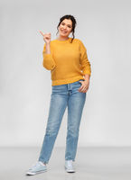happy smiling young woman pointing finger up