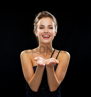 laughing woman in evening dress holding something