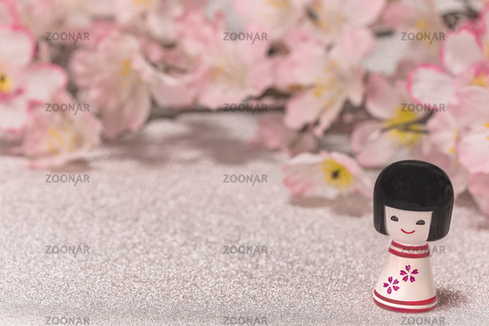 Japanese New Year's Cards with little doll Kokeshi with flower pattern on a glitter