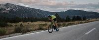 triathlon athlete riding bike
