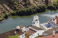 Altstadt von Mertola mit Rio Guadiana und Uhrturm, Alentejo, Portugal, old town of Mertola with Guadiana river and clock tower, Alentejo, Portugal