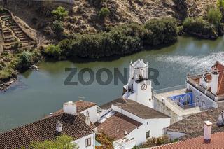 Altstadt von Mertola mit Rio Guadiana und Uhrturm, Alentejo, Portugal, old town of Mertola with Guadiana river and clock tower, Alentejo, Portugal