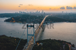 Istanbul Bosphorus Bridge at Sunset with Car traffic lights and City Skyline, Aerial View