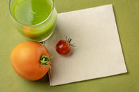 glass of green cucumber juice with tomato