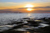 Sunset by Seaside Rocks