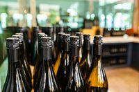 new wine bottles on winery bottling line